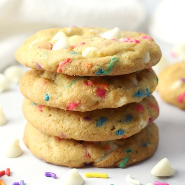 A stack of cookies with rainbow sprinkles.