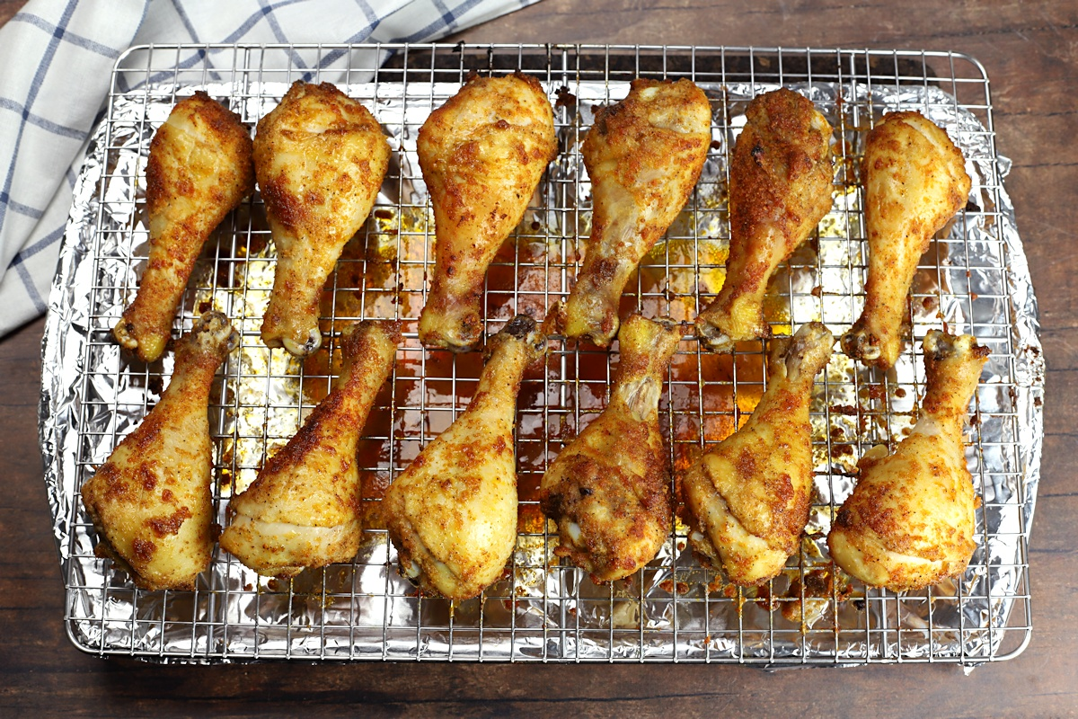 Sheet pan with a dozen chicken drumsticks