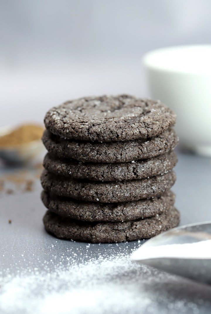 A stack of chocolate cookies on a grey counter top
