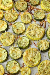 Zucchini and yellow squash discs sprinkled with parmesan cheese.