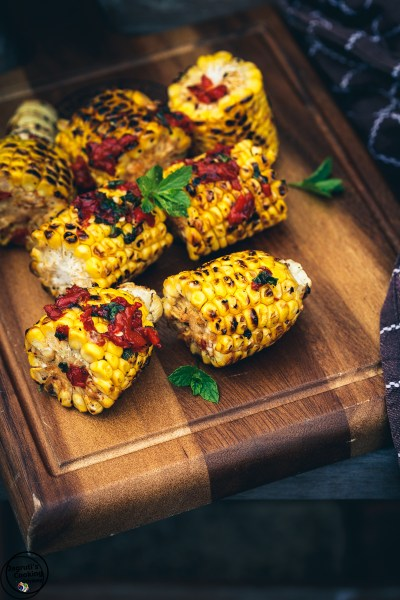 Barbecued Sweetcorn with Roasted Pepper, Honey and Sumac Salsa Dressing