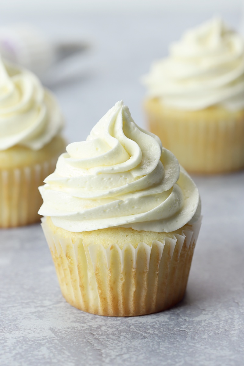 Close up of a white frosted cupcake.
