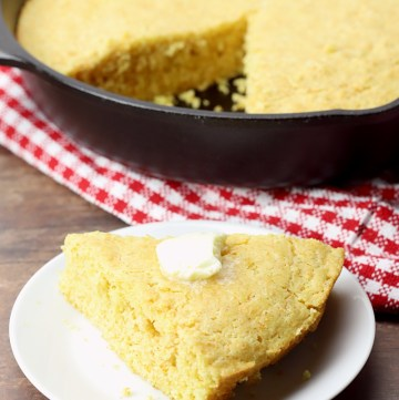 Piece of cornbread on a plate.