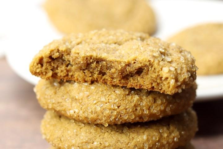 Half of a molasses cookie, revealing a moist center.