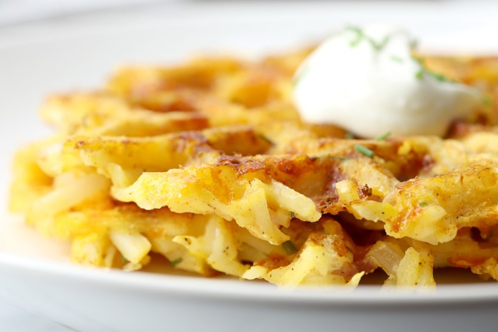 Crispy edges of shredded hash browns in waffles.