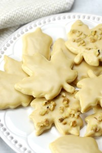 A maple leaf cookie with maple glaze on top.