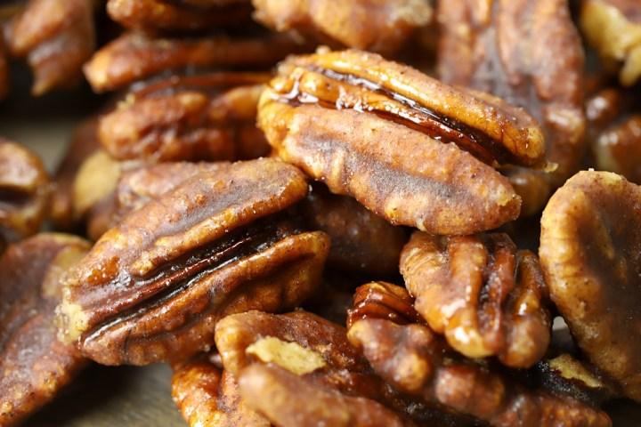 Close up of pecans with cinnamon sugar coating.