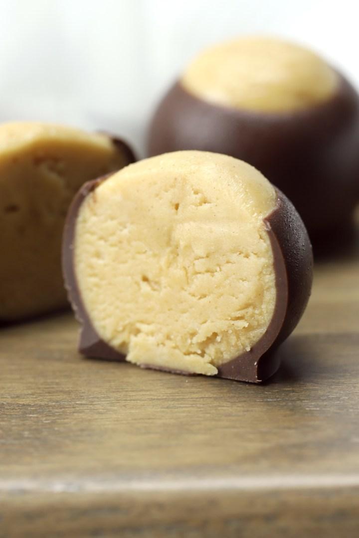 A peanut butter buckeye sliced in half.