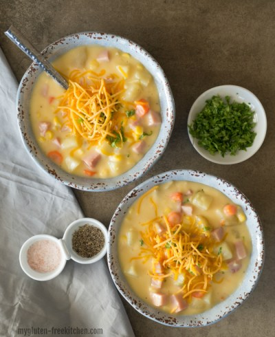Chowder topped with shredded cheese in two bowls.