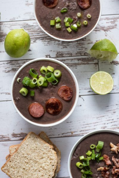 Black bean soup topped with sausage and green onions.