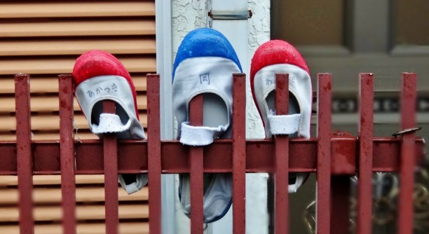 "Shoes on a fence, an example of ""outdoor closets"""