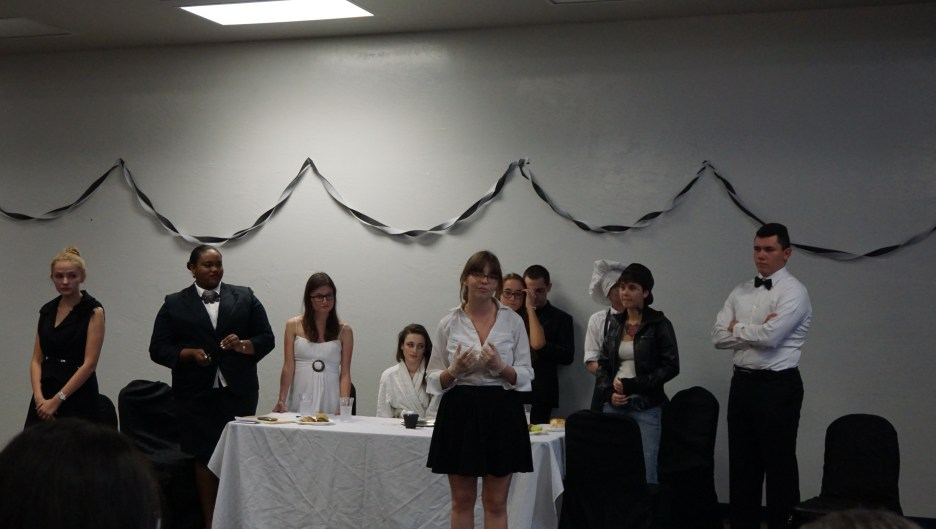 Junior Stephanie Young speaks to the audience during the Murder Cafe performance. Other actors, from right to left, include junior Juan Castillo, senior Stephanie Young, freshman Jessica Romer, junior Taylor Long, senior Allison Wilson, senior Javonda Carter and junior Catherine Hollows.