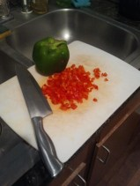 Chop your red and green peppers
