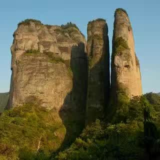 Three giant stone pillars of Mount Jianglang