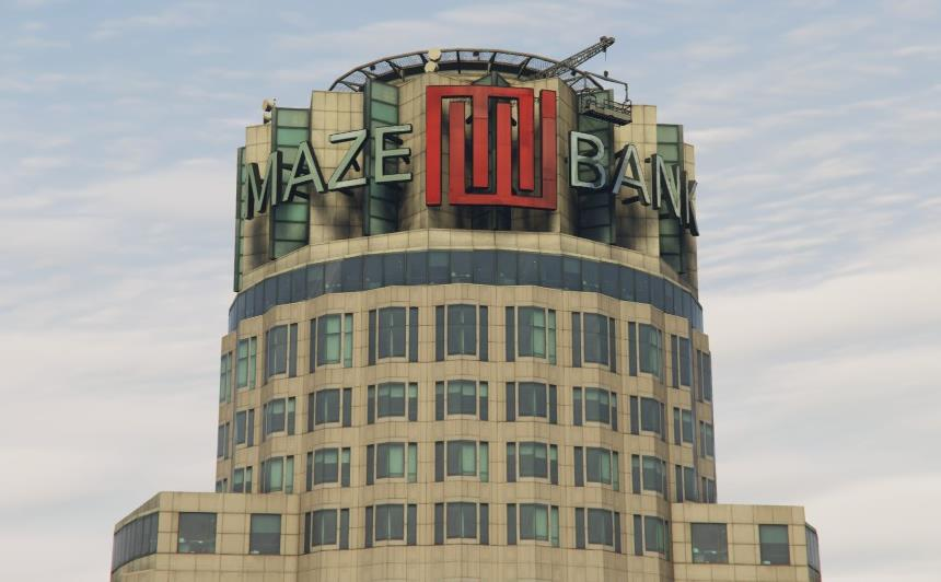 The logo of Maze Bank installed on the crown of the tower