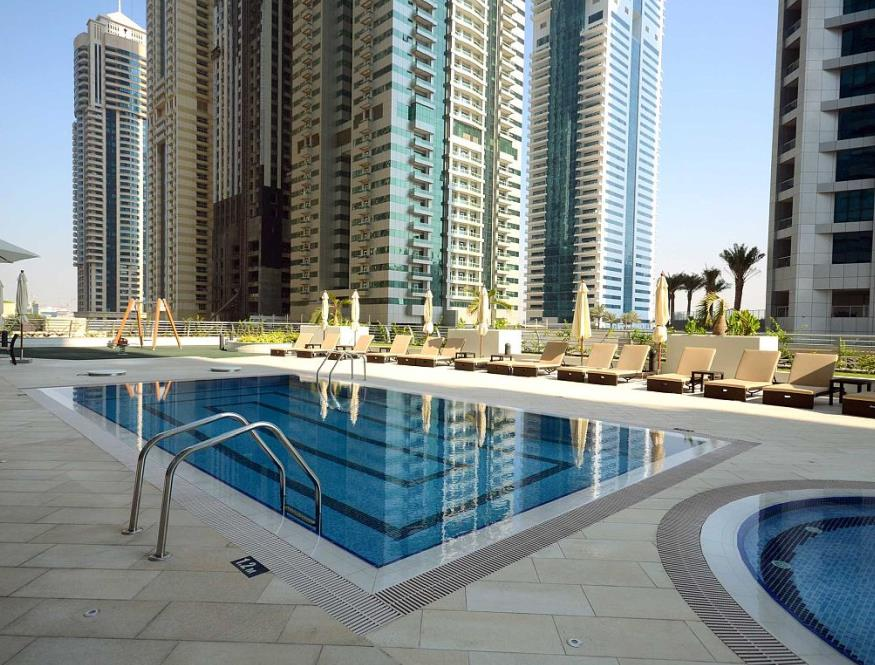 The outdoor swimming pool on the podium of the Princess Tower