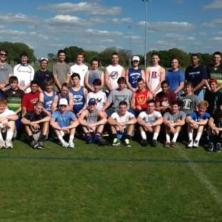 The boys lacrosse team gathers on the field for a picture in Florida. photo courtesy: Bill McGowan/World Class Lacrosse