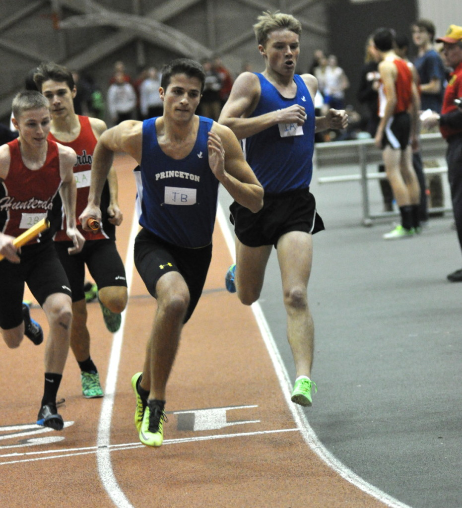 Joe Gray '15 starts out on his 400 meter leg of the Distance Medley Relay after taking the baton from Jacob Rist '15. photo courtesy: Joe Gray