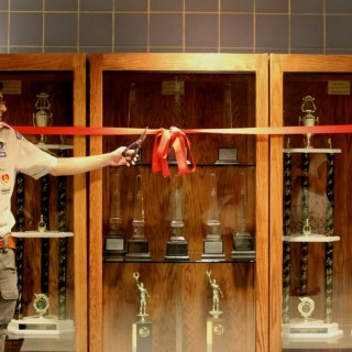 Ryan D'Souza '15 unveils his Eagle Scout project during his presentation at the band dance on February 22. D'Souza built trophy cases for the PHS bands. photo:  Severine Stier