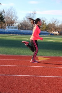 Amy Watsky '17 runs sprints during practice on December 12. photo: Annie Gao