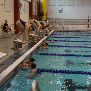Princeton High School girls swim team practices diving at John Witherspoon Middle School pool. Photo: Nathan Drezner