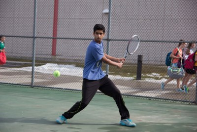 Rishab Tanga '15 practices his backhand during team tryouts on March 15.  Photo: Nathan Drezner