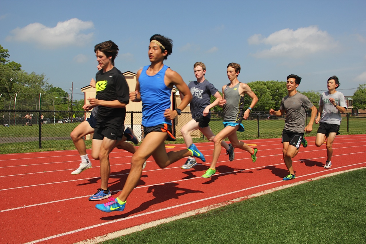 Distance runners Noah Chen '16 and Nick Delaney '18 lead practice on May 19 at the Princeton High School track.  Photo: Amy Wang