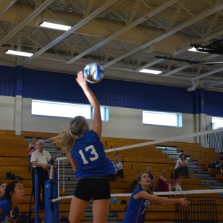 photo: Anne Sullivan-Crowley Captain Ashley Smithers '16 spikes the ball at one of PHS's few home games against Burlington County High School on Sept. 16.