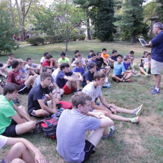 photo: Nathan Drezner Head Coach Mark Shelley briefs runners on their group distance workouts for Friday, September 19.