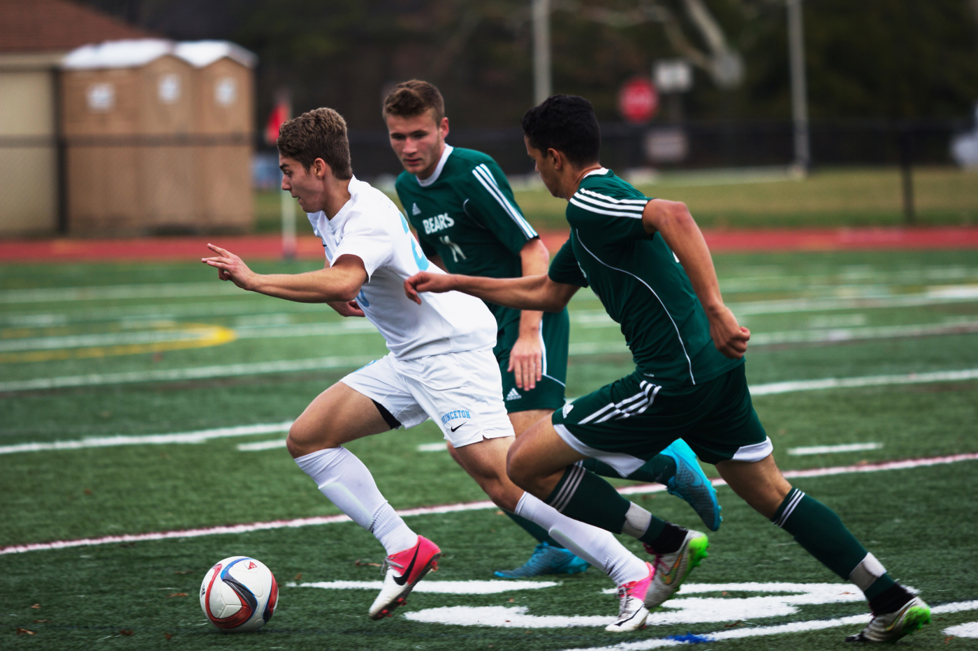 Alex Ratzan '17 breaks past the defensive line at the Little Tiger's game against East Brunswick High School. The team won 3–1. Photo: Nathan Drezner