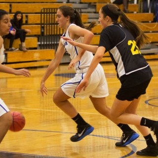 Power forward Zoe Tesone '17 drives the ball up the court with Sofia Manekia '18 to offer offensive help behind. Photo: Nathan Drezner