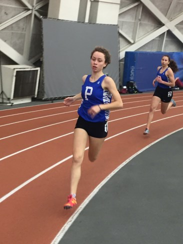 Lou Mialhe '16 and Jackie Patterson '18 compete in the 800-meter run at the PHS Elite Meet on February 3. Mialhe won the race in 2 minutes, 23.64 seconds. photo: Elliot Wailoo