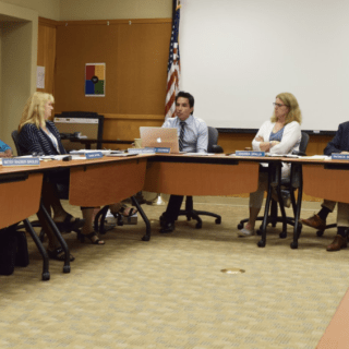 """Board of Education members discuss the Princeton Charter School's proposal, a petition to expand the school's enrollment by 76 students. photo by [credit name=""""Annie Kim""""]"""
