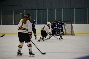 """<span class=""""credit credit- """"><a href=""""/credit/""""Valeria/"""" title=""""View all of this person's work"""">""""Valeria</a></span> Alexa Zammit '18 defends against a forward from Summit High School in an 8–5 loss."""
