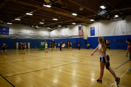 "Celia Gleason '17 throws and catches with the softball team at practice during a warmup drill on 4/25. The team has five games remaining during the regular season. photo by <span class=""credit credit- ""><a href=""/credit/""Aaron/"" title=""View all of this person's work"">""Aaron</a></span>"