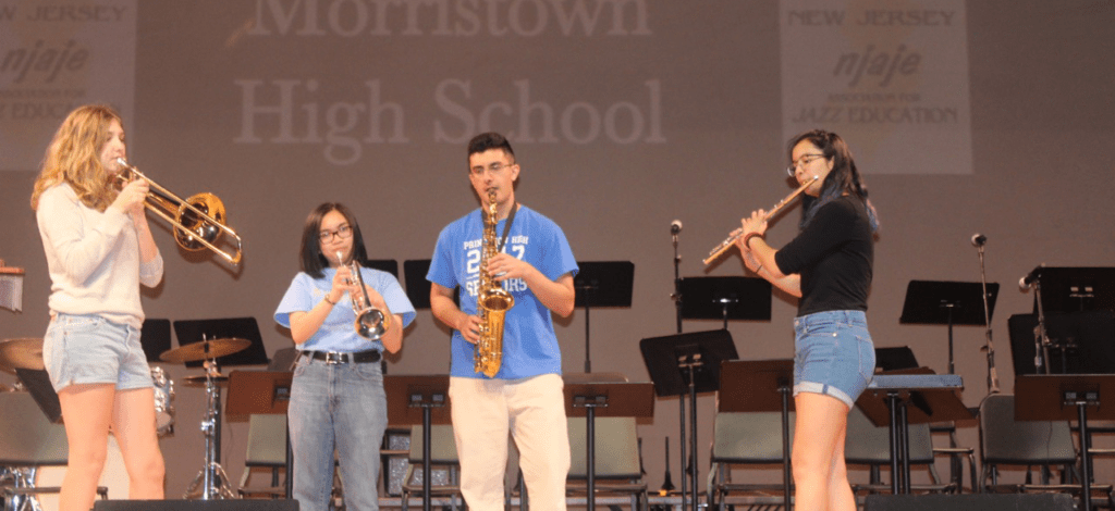 """(From left to right) Zoe O'Beirne '19, Naomi Barrales '19, Ashvick Awasthi '17, and Selia Gupta '18 practice in the PAC, where they performed for the NJ state final competition. They will perform again this Friday and Saturday with the PHS bands at Princeton's Jazz. photo by <span class=""""credit credit- """"><a href=""""/credit/""""Aaron/"""" title=""""View all of this person's work"""">""""Aaron</a></span>"""