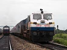 The Daily Rajdhani from Dibrugarh Town to New Delhi skips Dhupguri via loop line with SGUJ WDP-4B #40032