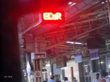 The Coach Indication board, flashing East Coast Railway's abbreviation at Visakhapatnam Jn