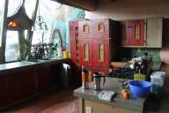 The kitchen was very open with a custom refrigerator behind the red doors.