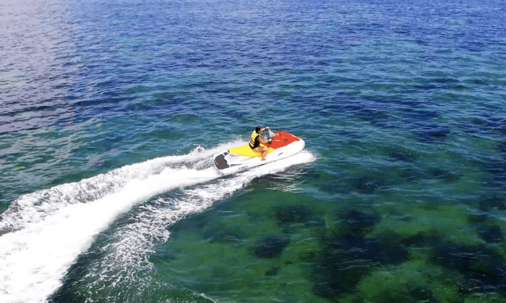 , Flying a Drone Over a Jet Ski in Bali (Video), The Travel Bug Bite