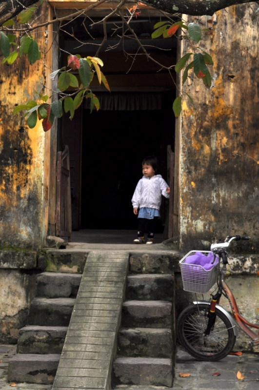 Small Child in Hoi An Doorway, Vietnam