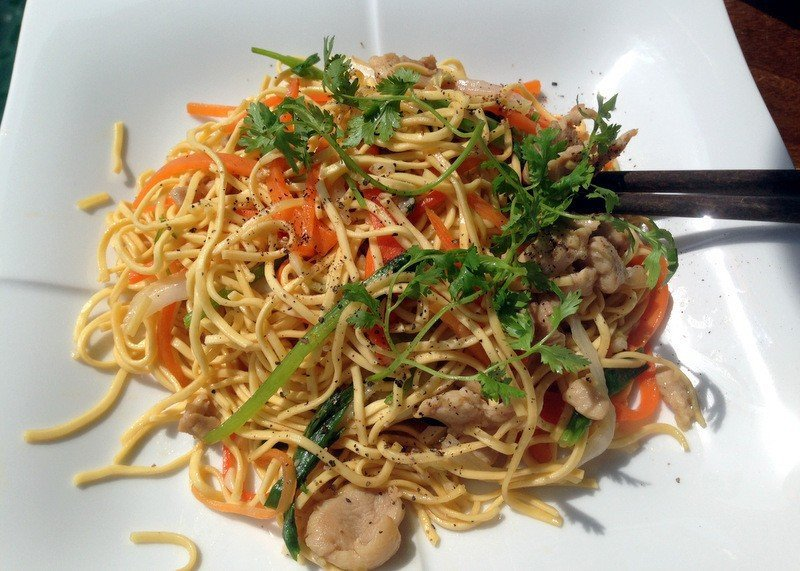 Noodles herbs meat dish