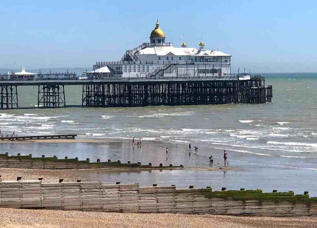 Eastbourne Pier and beach on sunny day