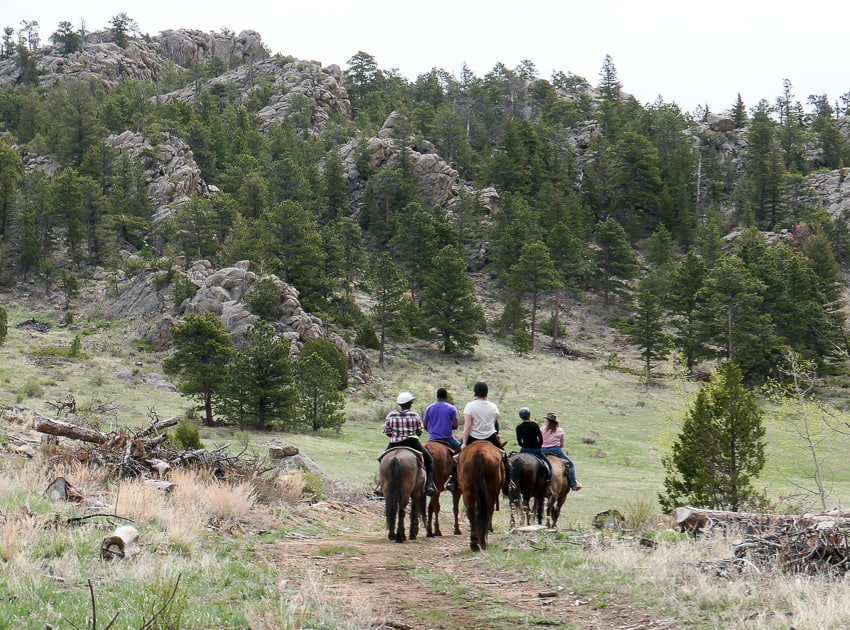 A group of horse back riders out in Arapaho National Park