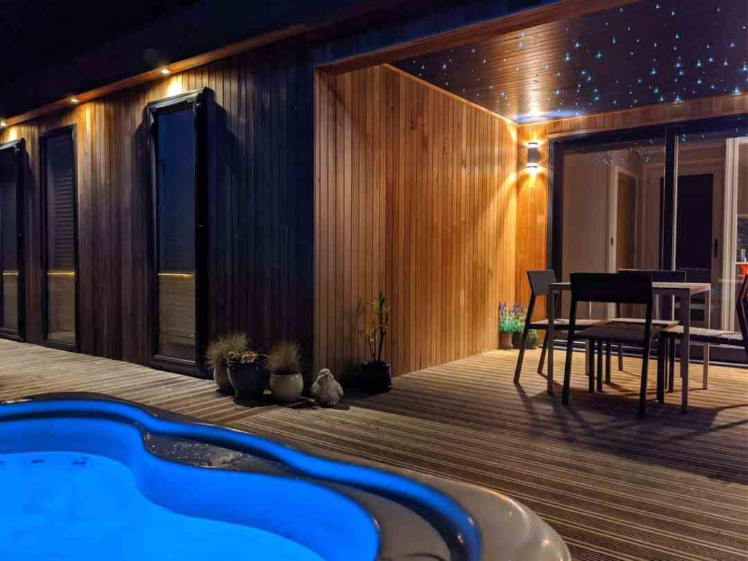 Strawberryfield luxury lodges hot tub at night