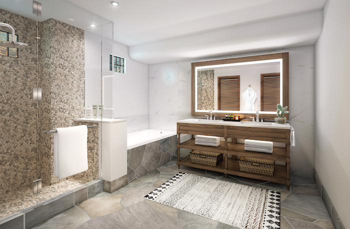 Tub time! This bathroom invites in relaxation.