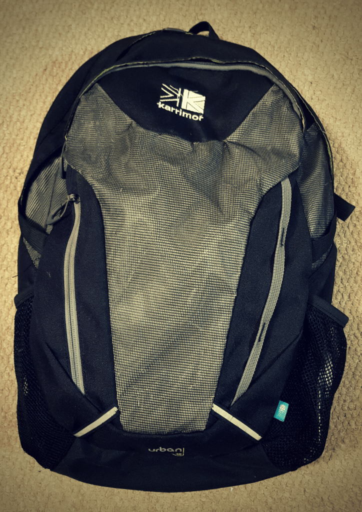 Grey and Black backpack with white Karrimor logo