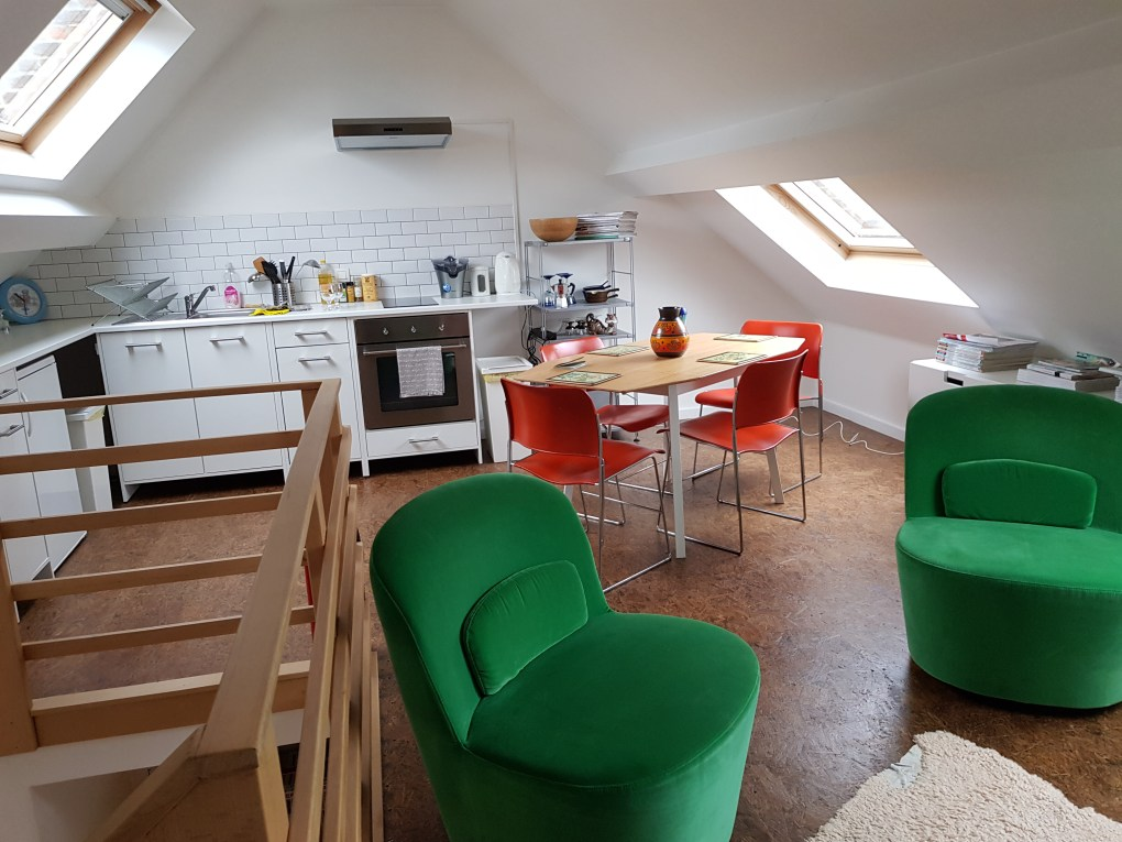 The kitchen, dining and living area in the upstairs area of the airbnb