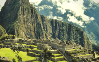 A shot of Machu Picchu ancient city with a mountain in the background