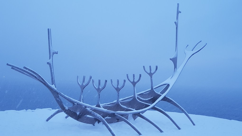 A metal statue of a viking ship